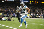 Carolina Panthers running back Christian McCaffrey (22) scores a touchdown, during the first half at an NFL football game against the New Orleans Saints, Sunday, Nov. 24, 2019, in New Orleans. (AP Photo/Butch Dill)