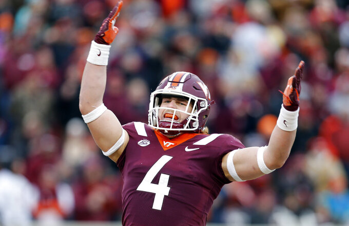Virginia Tech linebacker Dax Hollifield (4) tries to get the crowd stirred up during the first half of an NCAA college football game against Virginia in Blacksburg, Va., Friday, Nov. 23, 2018. (AP Photo/Steve Helber)
