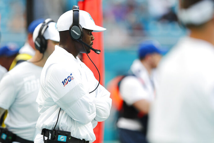 Miami Dolphins head coach Brian Flores looks from the sidelines, during the second half at an NFL football game against the Baltimore Ravens, Sunday, Sept. 8, 2019, in Miami Gardens, Fla. The Ravens defeated the Dolphins 59-10. (AP Photo/Brynn Anderson)