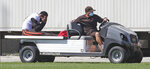 Cleveland Browns linebacker Mack Wilson is carted off the field by support staff after injuring his knee in a 7-on-7 drill during NFL football training camp, Tuesday, Aug. 18, 2020, in Berea, Ohio. (John Kuntz/The Plain Dealer via AP)