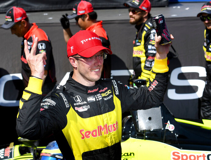 FILE - In this March 11, 2018, file photo, Sebastien Bourdais (18) celebrates after winning the IndyCar Firestone Grand Prix of St. Petersburg, in St. Petersburg, Fla. No matter the part, what Bourdais can do in a race car and the kind of competitor he is have made it clear that he's still among the very elite at his craft. (AP Photo/Jason Behnken, File)