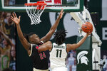 Michigan State guard A.J. Hoggard (11) drives on Nebraska forward Yvan Ouedraogo (24) in the first half of an NCAA college basketball game in East Lansing, Mich., Saturday, Feb. 6, 2021. (AP Photo/Paul Sancya)