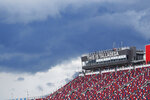 Storm clouds move into the area during the NASCAR Cup Series auto race at the Talladega Superspeedway in Talladega Ala., Monday, June 22, 2020. (AP Photo/John Bazemore)