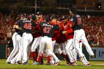 The Washington Nationals celebrate after Game 4 of the baseball National League Championship Series Tuesday, Oct. 15, 2019, in Washington. The Nationals won 7-4 to win the series 4-0. (AP Photo/Jeff Roberson)