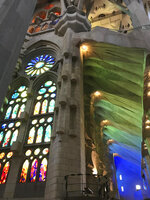 This Oct. 14, 2019 photo shows colored light filtering through the stained-glass windows of Basílica de Sagrada Família, Anton Gaudí's unfinished landmark, in Barcelona, Spain. (Courtney Bonnell via AP)