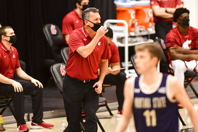 Washington State head coach Kyle Smith calls a play in the first half of an NCAA college basketball game against Montana State, Friday, Dec. 18, 2020, in Pullman, Wash. (Pete Caster/Lewiston Tribune via AP)
