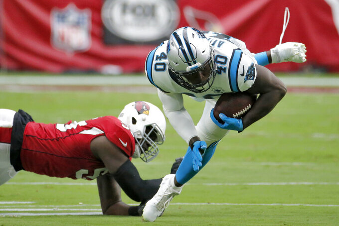 Carolina Panthers fullback Alex Armah (40) is tripped up by Arizona Cardinals linebacker Chandler Jones (55) during the first half of an NFL football game, Sunday, Sept. 22, 2019, in Glendale, Ariz. (AP Photo/Rick Scuteri)
