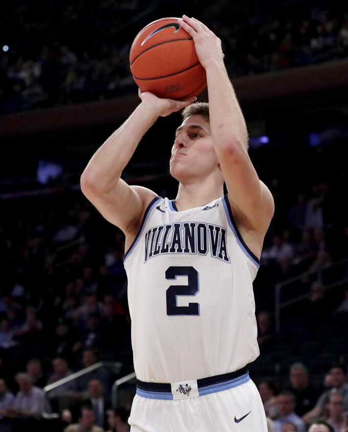 Villanova guard Collin Gillespie shoots against Xavier during the first half of an NCAA college basketball semifinal game in the Big East men's tournament, Friday, March 15, 2019, in New York. (AP Photo/Julio Cortez)
