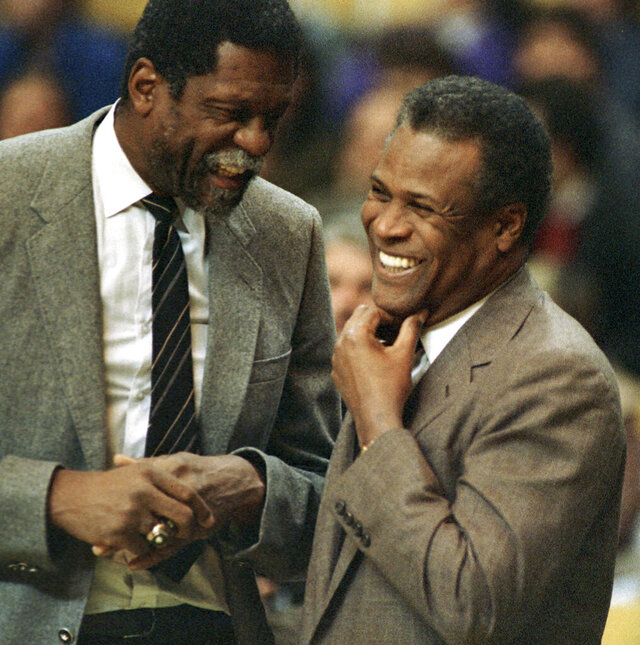 FILE - In this Jan. 15, 1988, file photo, former Boston Celtics teammates Bill Russell, Sacramento Kings coach, left, and K.C. Jones, Celtics coach, meet before the start of the Kings-Celtics NBA basketball game at the Boston Garden in Boston. Basketball Hall of Famer K.C. Jones, who won eight NBA championships as a Celtics player in the 1960s and two more as the coach of the Bostons team that took the titles in 1984 and '86, has died. He was 88. (AP Photo/Mike Kullen, File)