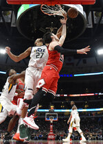 Utah Jazz center Rudy Gobert (27) defends Chicago Bulls guard Ryan Arcidiacono (51) during the first half of an NBA basketball game Saturday, March 23, 2019, in Chicago. (AP Photo/David Banks)