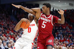 Dayton's Rodney Chatman (0) drives against Massachusetts' Samba Diallo (5) during the first half of an NCAA college basketball game, Saturday, Jan. 11, 2020, in Dayton. (AP Photo/John Minchillo)