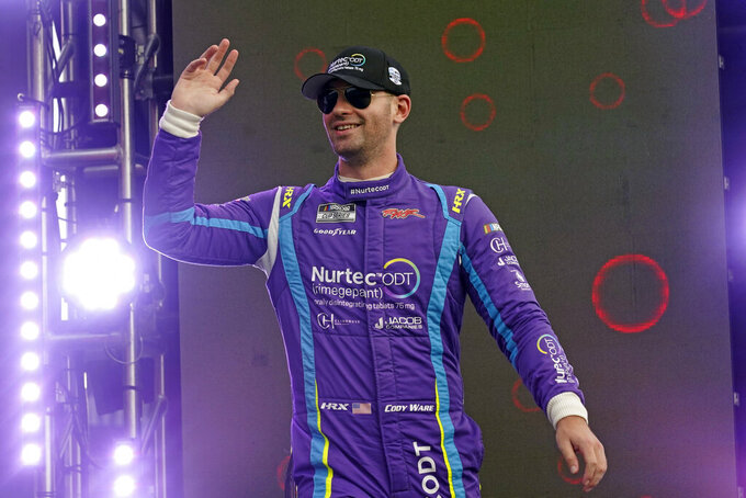Cody Ware waves to fans during driver introductions before the NASCAR Cup Series auto race at Daytona International Speedway, Saturday, Aug. 28, 2021, in Daytona Beach, Fla. (AP Photo/John Raoux)
