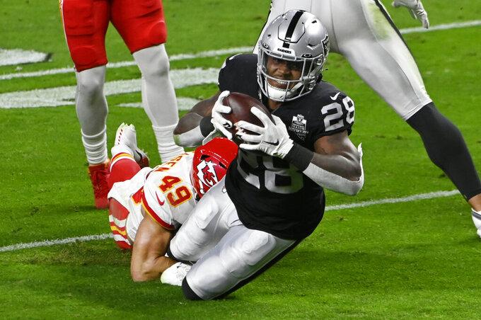 Kansas City Chiefs free safety Daniel Sorensen (49) tackles Las Vegas Raiders running back Josh Jacobs (28) during the first half of an NFL football game, Sunday, Nov. 22, 2020, in Las Vegas. (AP Photo/David Becker)