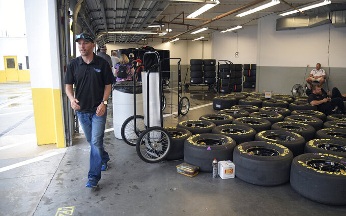 Ross Chastain leaves his garage during a weather delay before the NASCAR Cup Series auto race at Daytona International Speedway, Saturday, July 6, 2019, in Daytona Beach, Fla. (AP Photo/Phelan Ebenhack)