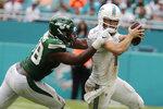 New York Jets outside linebacker Jordan Jenkins (48) sacks Miami Dolphins quarterback Ryan Fitzpatrick (14) during the second half of an NFL football game, Sunday, Nov. 3, 2019, in Miami Gardens, Fla. (AP Photo/Lynne Sladky)