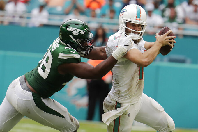 New York Jets outside linebacker Jordan Jenkins (48) sacks Miami Dolphins quarterback Ryan Fitzpatrick (14) during the second half of an NFL football game, Sunday, Nov. 3, 2019, in Miami Gardens, Fla. (AP Photo/Lynne Sladky)