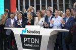 Peloton CEO John Foley, third from right, celebrates his company's IPO at the Nasdaq MarketSite, Thursday, Sept. 26, 2019, in New York. (AP Photo/Mark Lennihan)