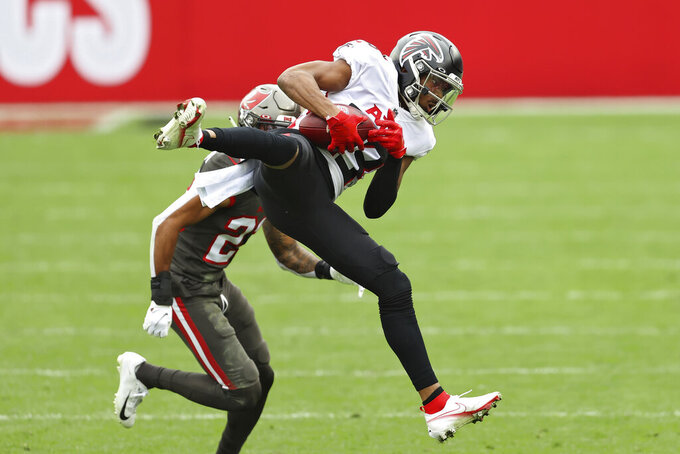 Atlanta Falcons wide receiver Russell Gage (83) makes a catch in front of Tampa Bay Buccaneers cornerback Sean Murphy-Bunting (23) during the first half of an NFL football game Sunday, Jan. 3, 2021, in Tampa, Fla. (AP Photo/Mark LoMoglio)