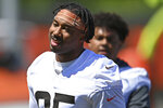 Cleveland Browns defensive linemen Myles Garrett smiles during an NFL football practice at the team's training facility, Thursday, June 17, 2021, in Berea, Ohio. (AP Photo/David Dermer)