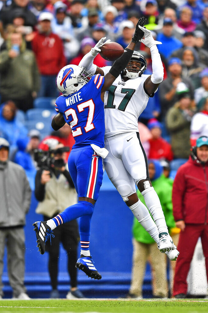 Philadelphia Eagles' Alshon Jeffery, right, can't make the catch while Buffalo Bills' Tre'Davious White defends him during the first half of an NFL football game, Sunday, Oct. 27, 2019, in Orchard Park, N.Y. (AP Photo/Adrian Kraus)