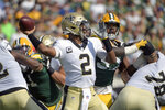 New Orleans Saints quarterback Jameis Winston (2) throws a pass during the first half of an NFL football game against the Green Bay Packers, Sunday, Sept. 12, 2021, in Jacksonville, Fla. (AP Photo/Phelan M. Ebenhack)