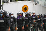 Police arrive outside the German Embassy in central Bangkok, Thailand, Monday, Oct. 26, 2020. Thai royalists gathered to defend pro-democracy protesters' contention that King Maha Vajiralongkorn spends much of his time in Germany conducting Thai political activities. German government officials have recently expressed concern over political activities the king might be conducting on the Germany's soil. (AP Photo/Gemunu Amarasinghe)