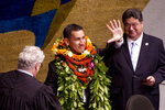 FILE - This Feb. 17, 2016 file photo shows state Sen. Kai Kahele, center, waving at the Hawaii State Capitol in Honolulu. While Tulsi Gabbard is campaigning for her party's presidential nomination, she faces a strong primary challenge back home for her congressional seat from fellow Democrat Kahele. At right is Senate President, Ron Kouchi. (Craig Kojima/Honolulu Star-Advertiser via AP, File)
