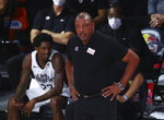 Los Angeles Clippers head coach Doc Rivers looks on against the Brooklyn Nets in the first half of an NBA basketball game Sunday, Aug. 9, 2020, in Lake Buena Vista, Fla. (Kim Klement/Pool Photo via AP)