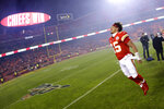 Kansas City Chiefs quarterback Patrick Mahomes celebrates as he comes off the field after an NFL divisional playoff football game against the Houston Texans, Sunday, Jan. 12, 2020, in Kansas City, Mo. (AP Photo/Charlie Riedel)