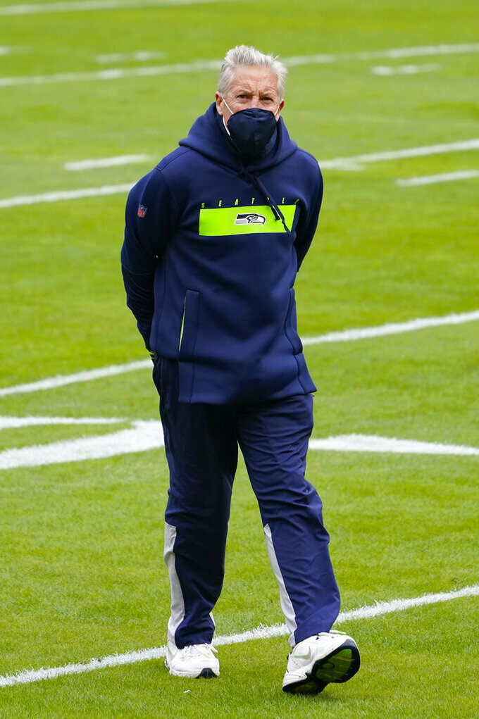 Seattle Seahawks head coach Pete Carroll walking on the field before the start of an NFL football game against the Washington Football Team, Sunday, Dec. 20, 2020, in Landover, Md. (AP Photo/Andrew Harnik)