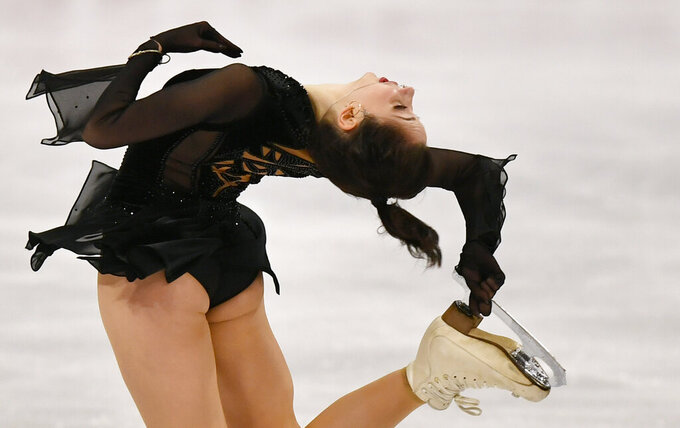 Russian skater Elizaveta Tuktamysheva performs during the Ladies Free Skating at the Figure Skating World Championships in Stockholm, Sweden, Friday, March 26, 2021. (AP Photo/Martin Meissner)
