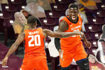 Illinois' Kofi Cockburn, right, celebrates one of his shots with Illinois' Da'Monte Williams (20) in the first half of an NCAA college basketball game, Saturday, Feb. 20, 2021, in Minneapolis. (AP Photo/Jim Mone)