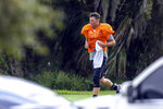 "FILE - In this May 19, 2020, file photo, Tampa Bay Buccaneers quarterback Tom Brady runs across the field during a an NFL football workout at Berkeley Preparatory School in Tampa, Fla. Bruce Arians didn't give much thought to the prospect of opting out of trying to help Tom Brady win a Super Bowl with the Tampa Bay Buccaneers. The 67-year-old whose aggressive offensive philosophy is dubbed ""no risk it, no biscuit"" is one of the oldest head coaches in the NFL, as well as a cancer survivor who once retired because of health concerns.  (Chris Urso/Tampa Bay Times via AP, File)"