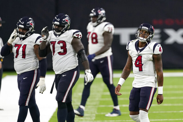 Houston Texans quarterback Deshaun Watson (4) walks off the field with teammates during the second half of an NFL football game against the Baltimore Ravens, Sunday, Sept. 20, 2020, in Houston. Baltimore won 33-16. (AP Photo/David J. Phillip)