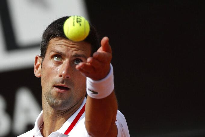 Novak Djokovic serves the ball to Alejandro Davidovich Fokina during their 3rd round match at the Italian Open tennis tournament, in Rome, Thursday, May 13, 2021. (AP Photo/Alessandra Tarantino)