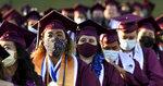Students wearing masks listen to speakers during the Mount Sac graduation at Hilmer Lodge Stadium in Walnut, Calif., Friday, June 11, 2021. (Keith Birmingham/The Orange County Register via AP)
