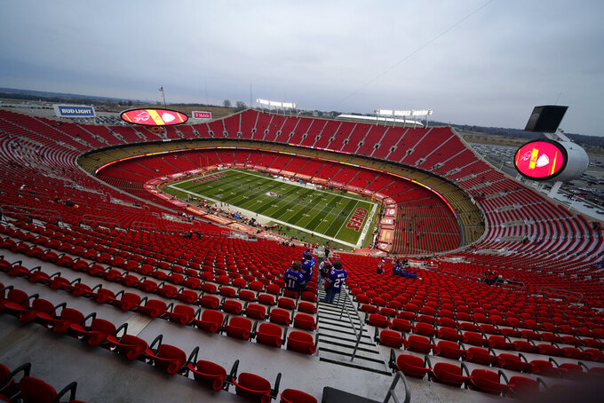 Fans watch players warm up before the AFC championship NFL football game between the Kansas City Chiefs and the Buffalo Bills, Sunday, Jan. 24, 2021, in Kansas City, Mo. (AP Photo/Charlie Riedel)