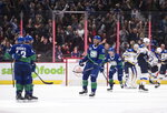 Vancouver Canucks' Josh Leivo (17) and Quinn Hughes (43) celebrate Hughes' goal against the St. Louis Blues during the third period of an NHL hockey game Tuesday, Nov. 5, 2019, in Vancouver, British Columbia. (Darryl Dyck/The Canadian Press via AP)
