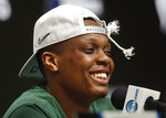 FILE - In this March 31, 2019, file photo, Michigan State guard Cassius Winston (5) smiles while answering questions during a news conference after beating Duke 68-67 in an NCAA men's East Regional final college basketball game, in Washington. Winston has joined a select group of players in program history as an All-America player and Big Ten player of the year. If he can help the Spartans win two more games, he'll join Magic Johnson and Mateen Cleaves as the school's national championship-winning point guards. (AP Photo/ Mark Tenally, File)