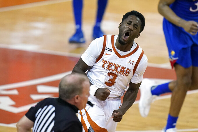 Texas guard Courtney Ramey celebrates after making a basket during the second half of an NCAA college basketball game against Kansas, Tuesday, Feb. 23, 2021, in Austin, Texas. (AP Photo/Eric Gay)