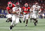 Georgia defensive back J.R. Reed (20) tries to tackle Alabama quarterback Jalen Hurts (2) during the second half of the Southeastern Conference championship NCAA college football game, Saturday, Dec. 1, 2018, in Atlanta. Hurts scored a touchdown on the play. (AP Photo/John Bazemore)
