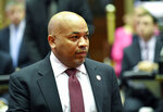 Assembly Speaker Carl Heastie, D-Bronx, left, walks on the Assembly floor as members of the New York state Assembly debate legislation that authorizes state tax officials to release, if requested, individual New York state tax returns to Congress during a vote in the Assembly Chamber at the state Capitol Wednesday, May 22, 2019, in Albany, N.Y. (AP Photo/Hans Pennink)