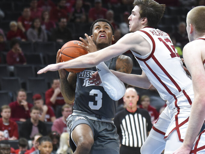Mississippi State guard D.J. Stewart Jr. (3) takes a foul from Oklahoma guard Austin Reaves (12) during the second half of an NCAA college basketball game in Oklahoma City, Saturday, Jan. 25, 2020. (AP Photo/Kyle Phillips)