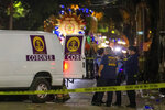 Emergency personnel work the scene after a person was run over and killed by a float in the Mystic Krewe of Nyx parade during Mardi Gras celebrations in New Orleans, Wednesday, Feb. 19, 2020. (AP Photo/Brett Duke)