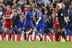 Chelsea's N'Golo Kante, center, celebrates after scoring his side's opening goal during the British premier League soccer match between Chelsea and Liverpool, at the Stamford Bridge Stadium, London, Sunday, Sept. 22, 2019. (AP Photo/Matt Dunham)