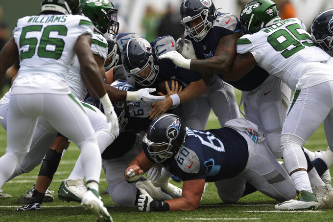 Tennessee Titans quarterback Ryan Tannehill (17) runs the ball during the first half of an NFL football game against the New York Jets, Sunday, Oct. 3, 2021, in East Rutherford. (AP Photo/Bill Kostroun)