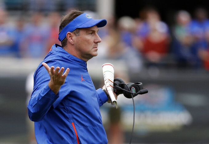 Florida head coach Dan Mullen questions a ruling by officials during the first half of an NCAA college football game against Georgia, Saturday, Oct. 27, 2018, in Jacksonville, Fla. (AP Photo/John Raoux)