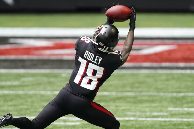 Atlanta Falcons wide receiver Calvin Ridley (18) makes a catch against the Chicago Bears during the first half of an NFL football game, Sunday, Sept. 27, 2020, in Atlanta. (AP Photo/John Bazemore)