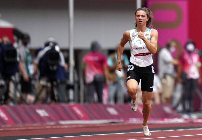 FILE In this file photo taken on Friday, July 30, 2021, Krystsina Tsimanouskaya, of Belarus, runs in action in the women's 100-meter race at the 2020 Summer Olympics. A feud between Tsimanouskaya and team officials that prompted her to seek refuge in Poland has again cast a spotlight on the repressive environment in the ex-Soviet nation, where authorities have unleashed a relentless crackdown on dissent. (AP Photo/Petr David Josek, File)