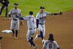 Houston Astros' Carlos Correa and George Springer celebrate after Game 5 of the baseball World Series against the Washington Nationals Sunday, Oct. 27, 2019, in Washington. The Astros won 7-1 to take a 3-2 lead in the series. (AP Photo/Alex Brandon)